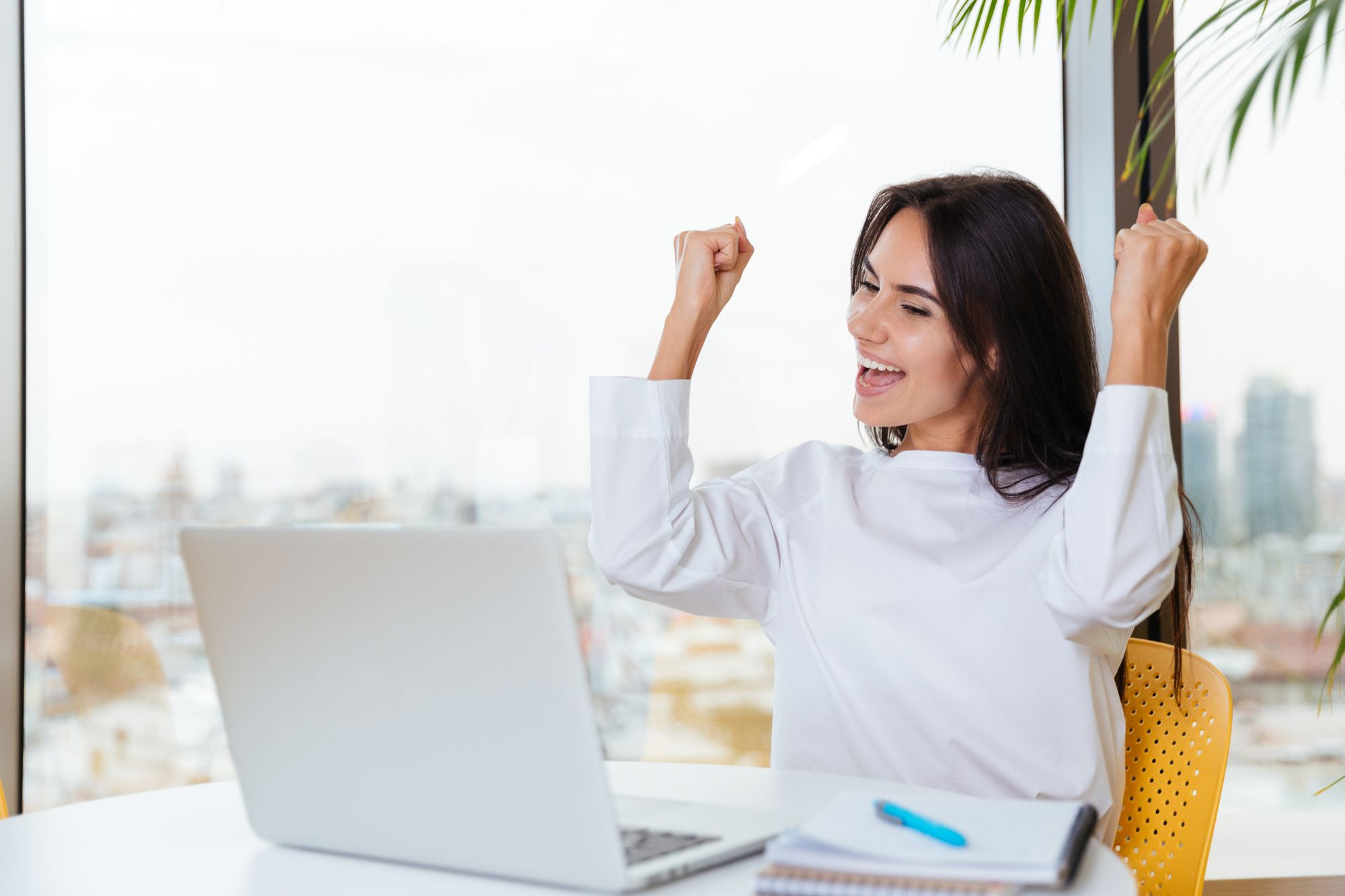 Financial advisor cheers after earning a financial advisor designation in a specialized field.